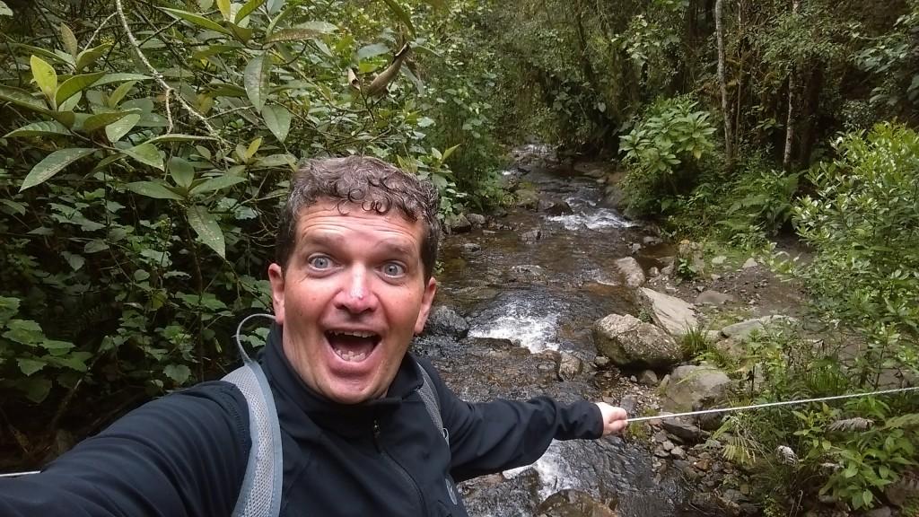 Walking across the river in Valle de Cocora