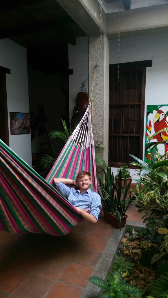 Tim relaxes in a hammock at Hostal Colonial