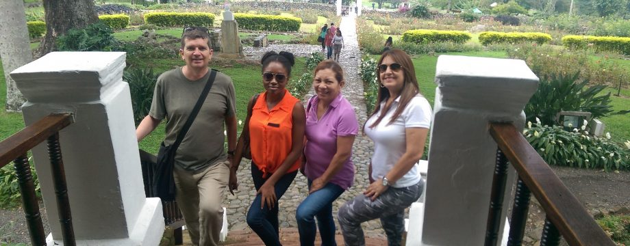 Standing on the steps of Hacienda El Paraiso with Max, Martha and Maritza