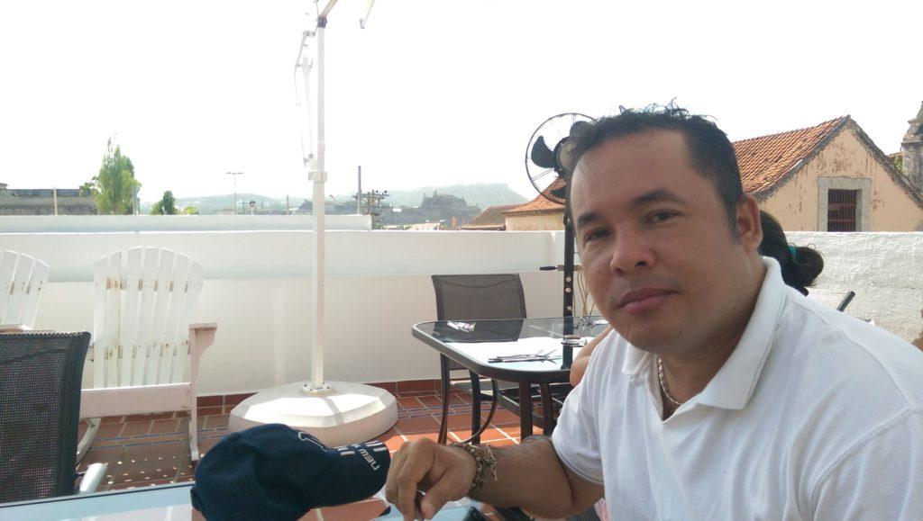 Alvaro having breakfast on the rooftop terrace