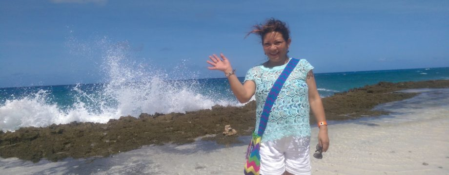 Martha about to get splashed by the wave behind her